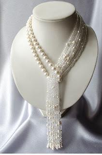 https://www.amazon.in/gp/search/ref=as_li_qf_sp_sr_il_tl?ie=UTF8&tag=fashion066e-21&keywords=heavy  pearls  Necklaces&index=aps&camp=3638&creative=24630&linkCode=xm2&linkId=09d233e57649432648fc94456b1fc9c3