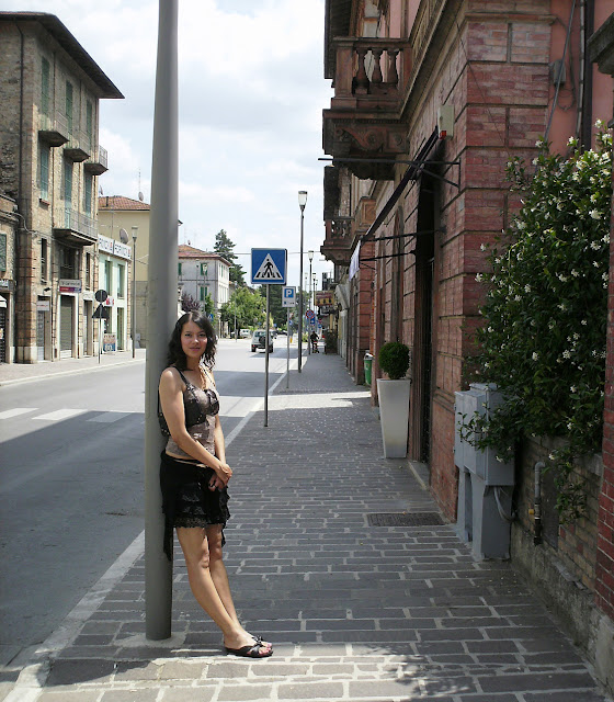 Anna-Christina sitting in Umbertide in Italy image