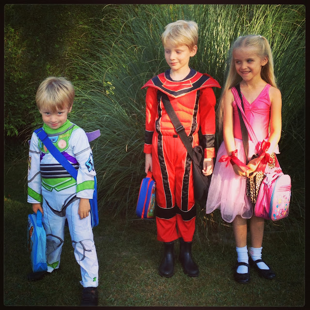 children dressed as superheroes for World Book Day
