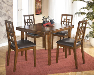 The most common material used in furniture making is wood. Wooden tables with glass top are the most popular variety in dining tables. Instead of plain wood, carving is done on the legs and the sides, to make the furniture look grand. Curved legs of the table look good too and give the table a sturdy appearance. The height and the shape of the chairs can be made unique as per the individual specifications.