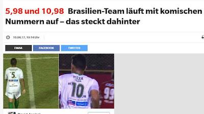 http://www.express.de/sport/fussball/5-98-und-10-98-brasilien-team-laeuft-mit-komischen-nummern-auf---das-steckt-dahinter-26689546?originalReferrer=