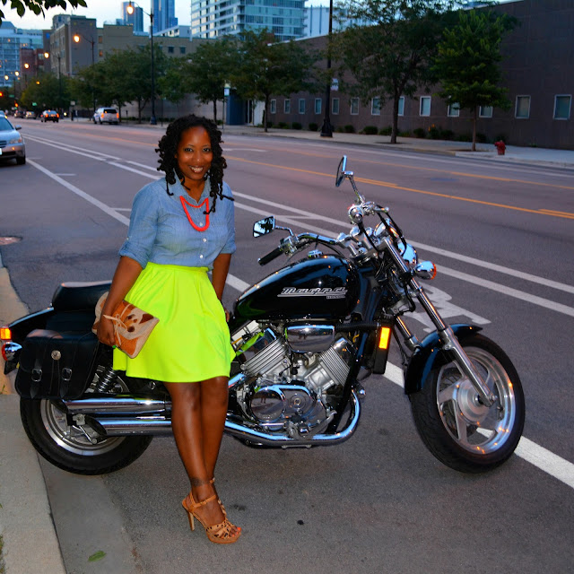 wearing neon skirt sitting on motorcycle