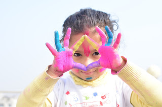 How to Celebrate Holi Festival in 2020 - Cute girl with colors of holi festival