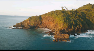 A royalty free of aerial drone shot of malimbu and pandanan sunset point , best place to watch and enjoy sunset in Lombok Indonesia