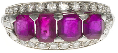 Pink sapphire and diamond ring. Via Diamonds in the Library.