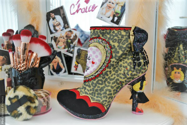 Irregular Choice Disney Muppets Fierce Piggy leopard print boots on vanity unit with makeup and mirror