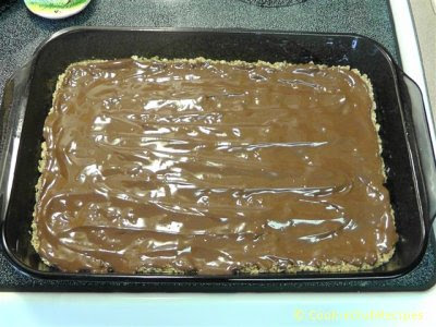 melted chocolate spread over cookie base