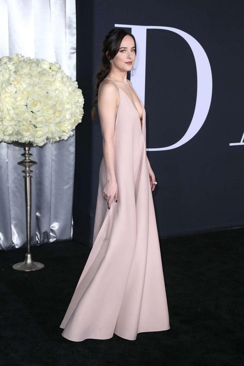 Dakota Johnson is braless at Fifty Shades Darker premiere