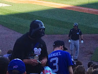 baseball Darth Vader mask in the crowd