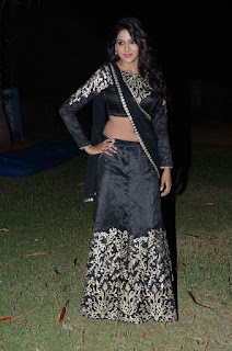 Actress Shalu Chourasiya Stills in Designer Black Lehenga Choli at Premikudu Movie Audio Launch  0050.jpg