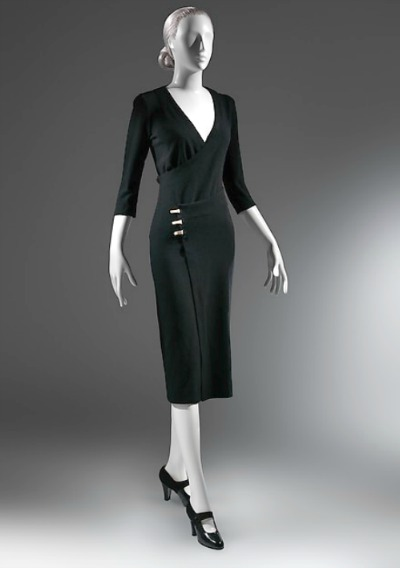 Black wrap dress by Charles James name Taxi Dress displayed on mannequin