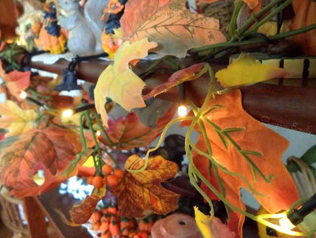 leaf garland with sting lights on a shelf