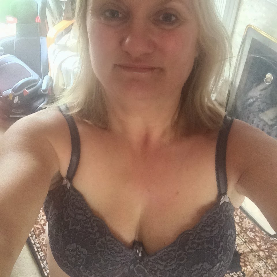 woman in bra after NHS breast reduction and uplift
