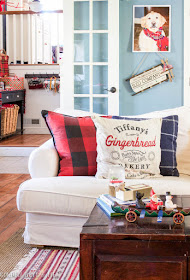 Plaid pillows on white slipcovered Ikea sofa as cozy and comfortable Christmas decor