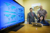 L to R: Dean and Director of the School of Marine and Atmospheric Sciences Minghua Zhang, Associate Professor of Political Science Oleg Smirnov, and Graduate Student Tingyin Xiao. (Credit: Stony Brook University) Click to Enlarge.
