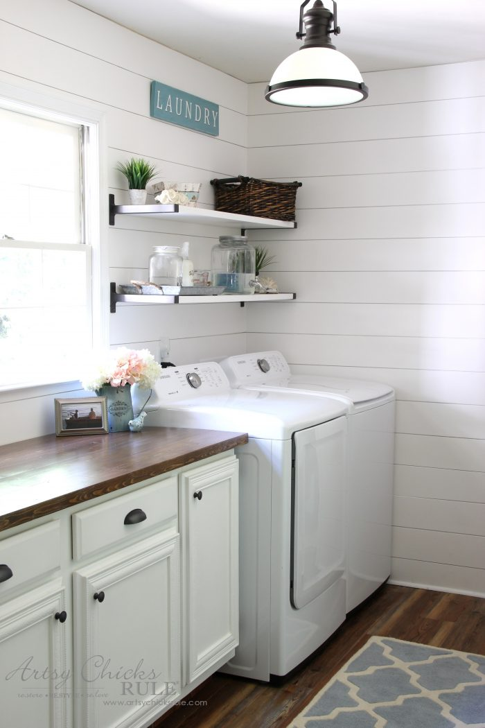 Bright laundry with shiplap and shelves