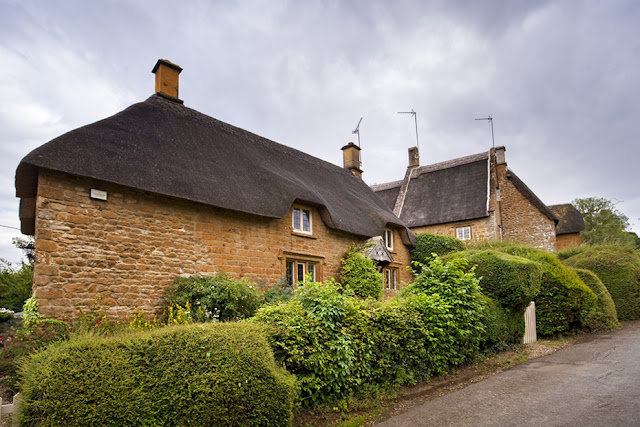 Thatched cottages in the Cotswold village of Great Tew by Martyn Ferry Photography