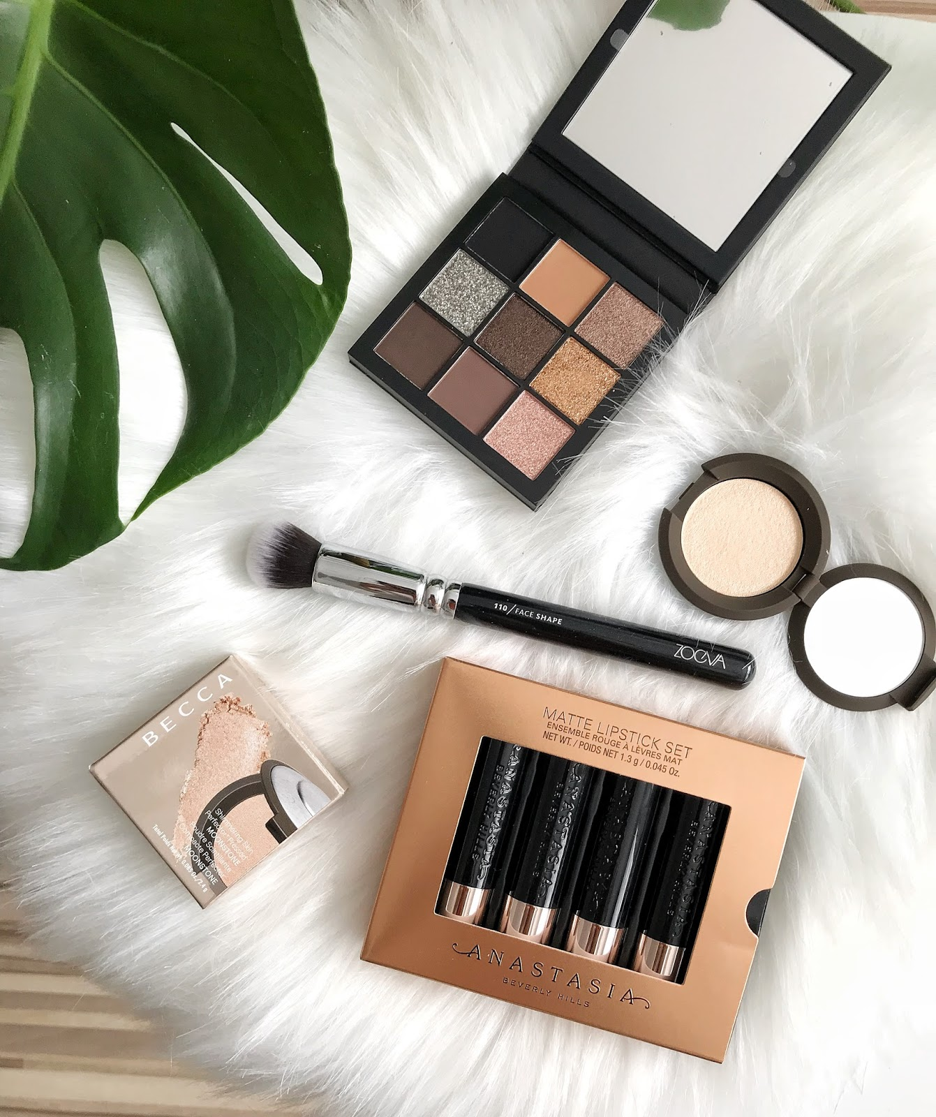ANASTASIA BEVERLY HILLS Mini Matte Lipstick Set - Nudes,  ZOEVA Face Shape Brush 110, BECCA Shimmering Skin Perfector Pressed Highlighter Mini Moonstone, HUDA BEAUTY Smokey Obsessions Palette