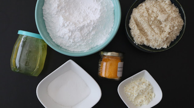Ingredients for making lemon macarons - icing sugar, almond meal, albumen, berry sugar/extra fine sugar, egg whites and yellow powder