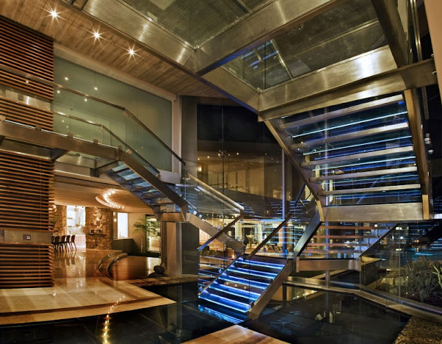 Photo of incredible glass staircase as seen from the ground floor