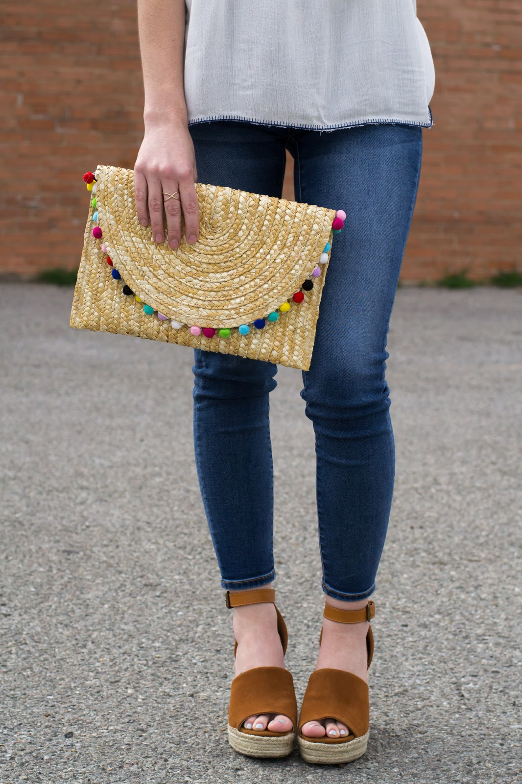 Straw pom pom clutch and wedge espradilles