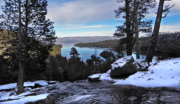 Eagle creek in foreground above waterfall, Emerald bay and mountains in background