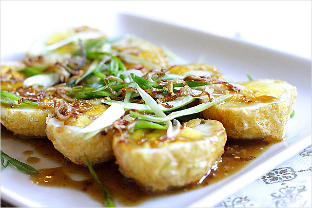 These hard boiled eggs topped with fresh scallions and a sauce is tasty.