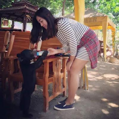 Lu Lu Aung Feeding Milk
