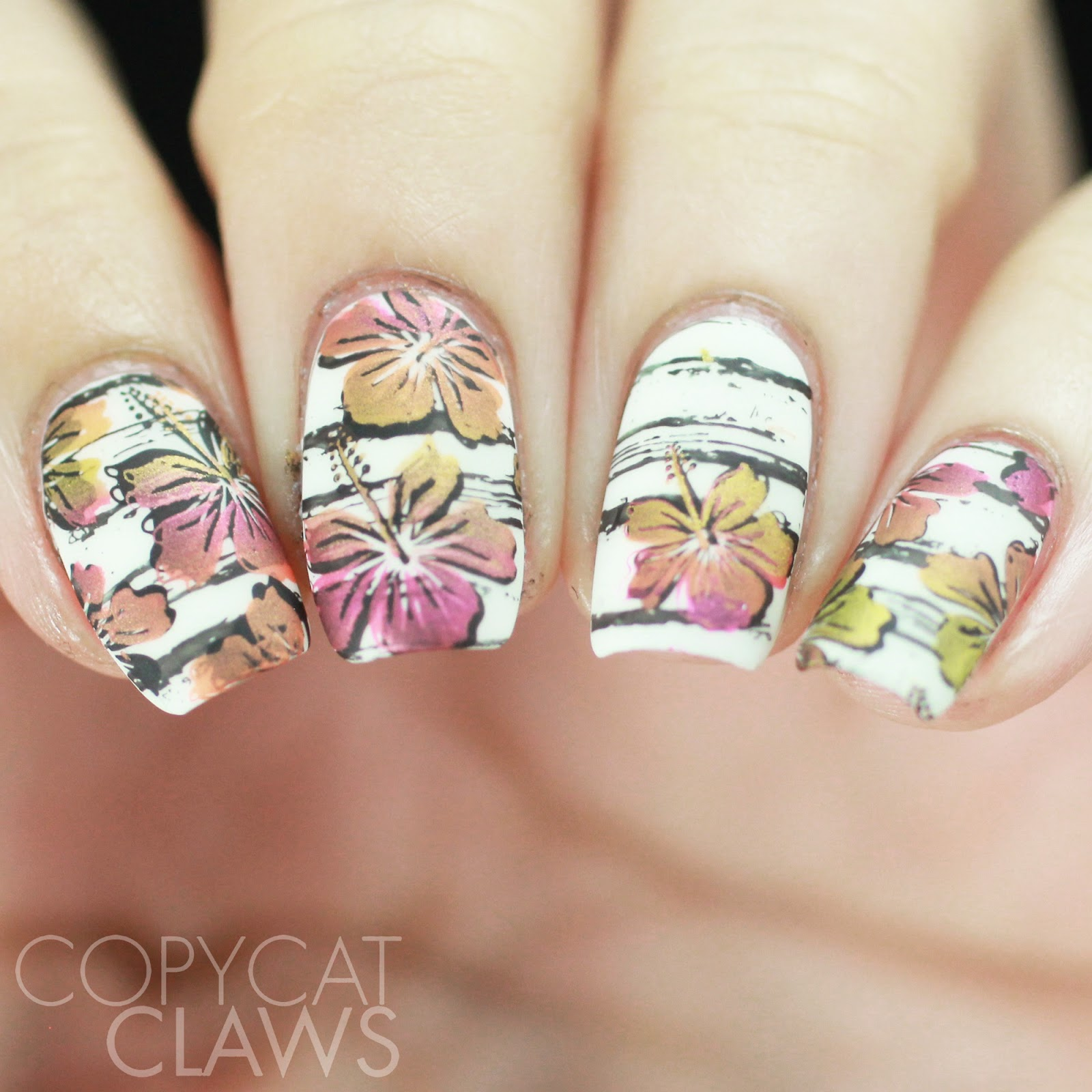 Copycat claws the digit al dozen does tropical hibiscus nails to start i used my favourite white kbshimmer eyes white open then i stamped the distressed lines with lina nail art supplies make your mark 02 and hit izmirmasajfo