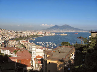 Vesuvius looms above the sprawling port city with its beautiful bay and panoramic views