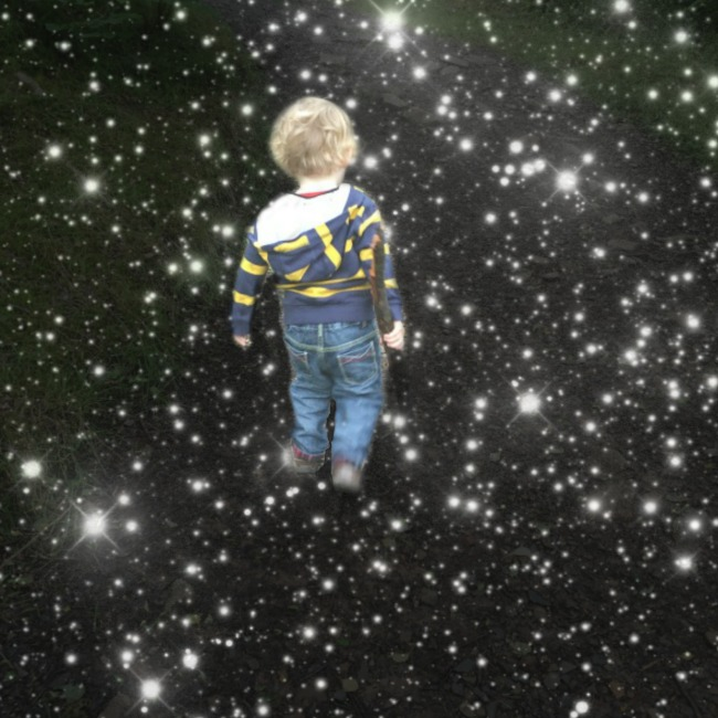 picture-of-toddler-standing-surrounded-by-black-sky-with-stars-in-it
