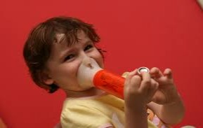 an asthmatic child using an inhaler
