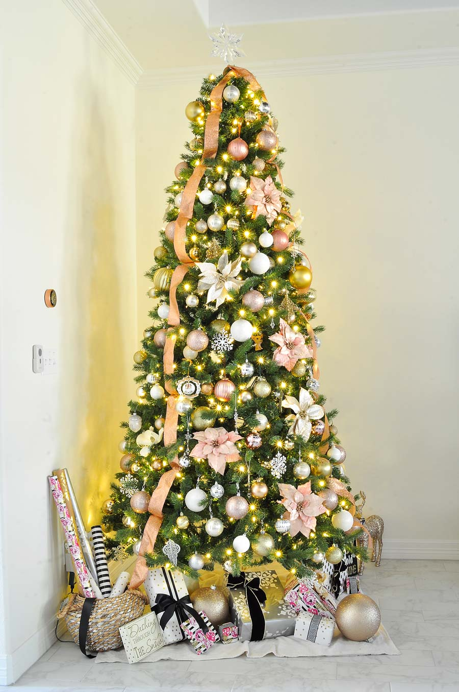 A beautiful and stunning blush, silver, white and gold Christmas tree. So much glam and sparkle!