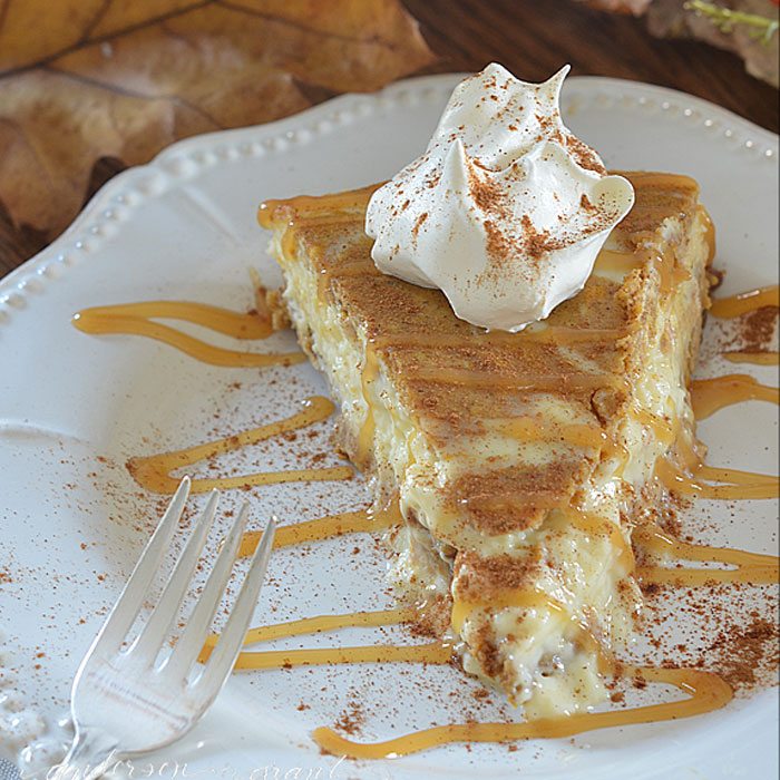 Slice of pumpkin cheesecake with caramel drizzle