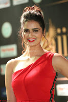 Meenakshi Dixit in Red One Shoulder Red Zipped up gown at IIFA Utsavam Award 49.JPG