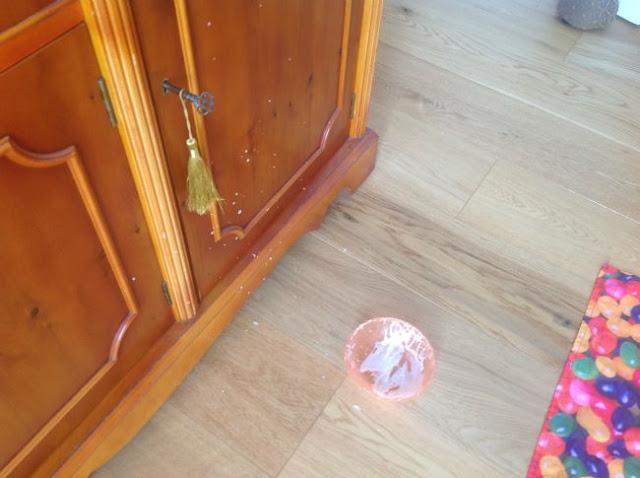 Bowl-on-floor-with-yoghurt-splashes