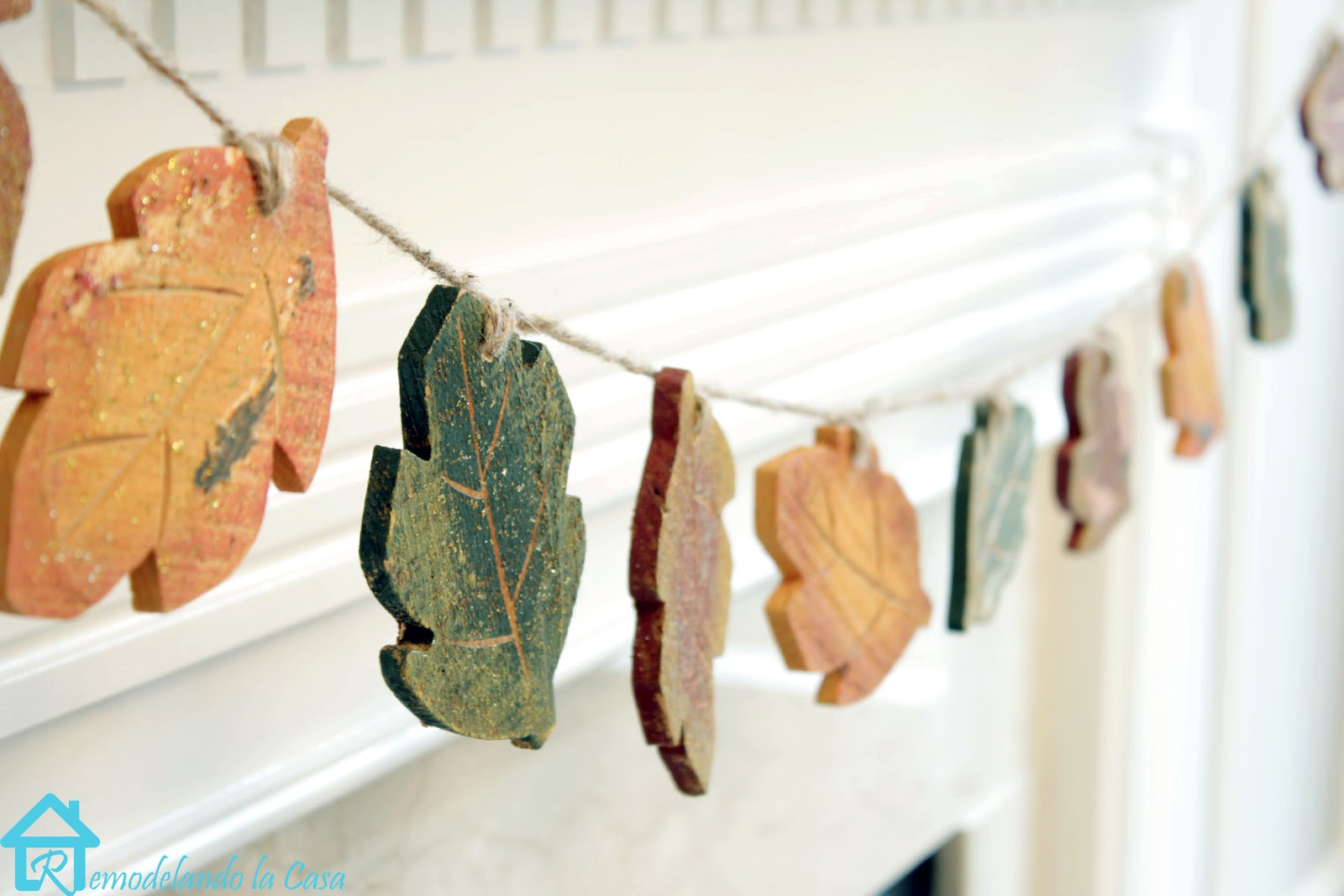 wooden leaves garland on a mantel