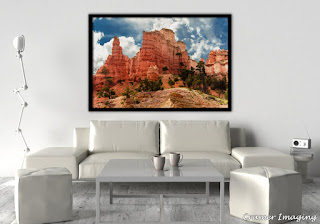 Photograph of Cramer Imaging fine art photograph 'Ancient Red Skyscrapers' on the wall of a living room setting