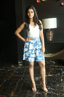 Yamini in Short Mini Skirt and Crop Sleeveless White Top 147.JPG