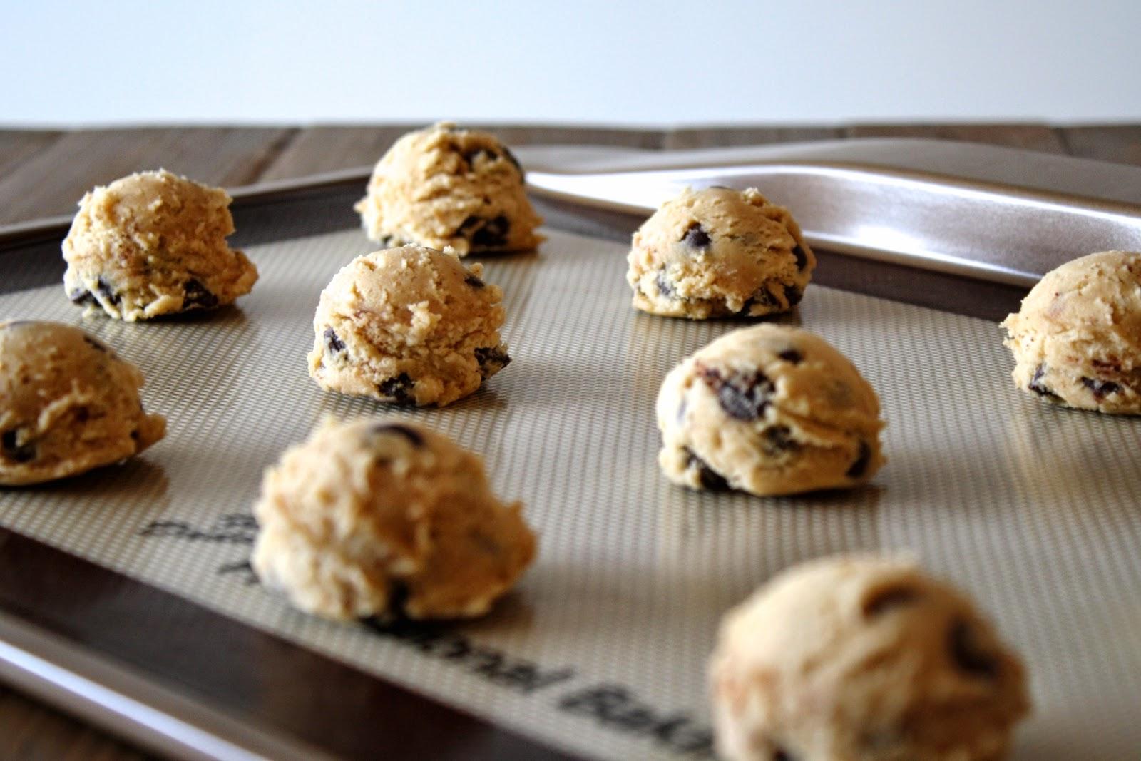 Cookie dough balls on a baking sheet.