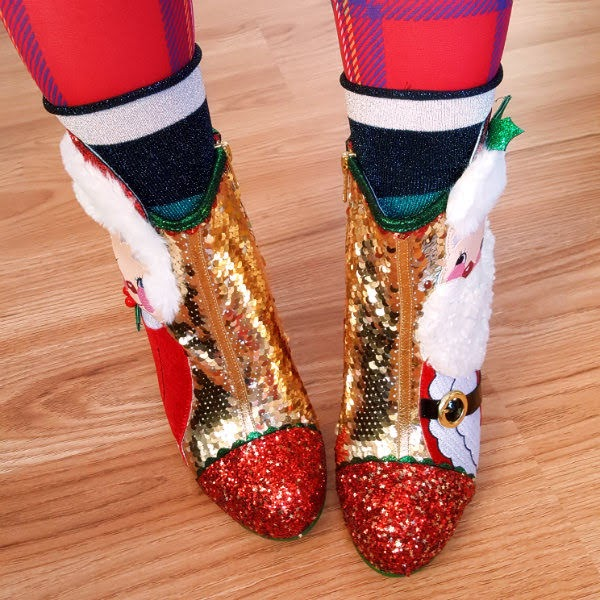 shoefie wearing striped glitter socks and gold sequin ankle boots with red glitter toes