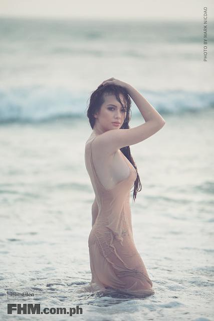 Ellen Adarna in beige dress braless standing at beach