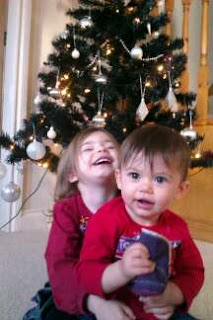 girls and christmas tree