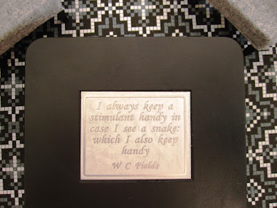 Modern one-twelfth scale miniature table top with W C Fields quote about drinking set into it.