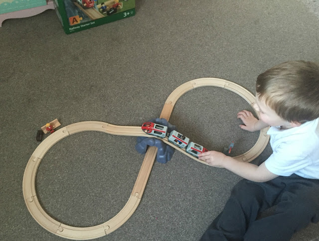 Playing with the wooden railway set