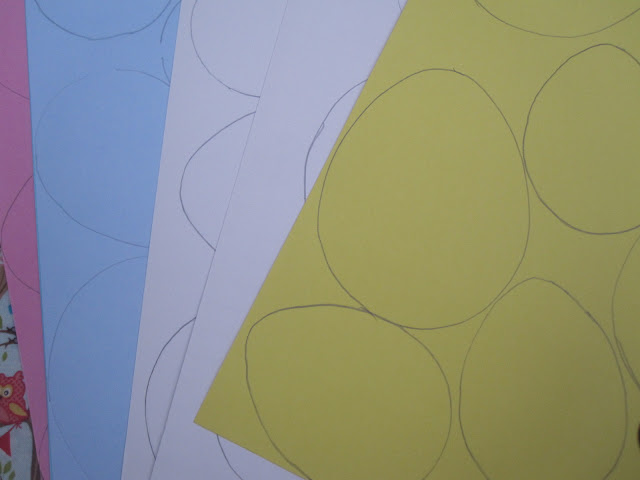 Different coloured card with eggs drawn on
