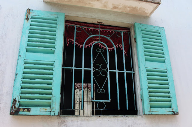 Rustic shutters along the Mekong Delta, Vietnam - lifestyle and travel blog