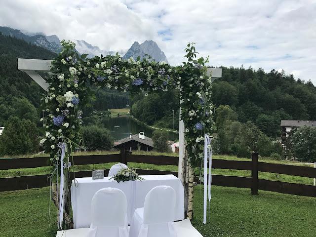 Ceremony flower arch, Wedding abroad, Mountain wedding lake-side at the Riessersee Hotel Resort Bavaria, Germany, Garmisch-Partenkirchen
