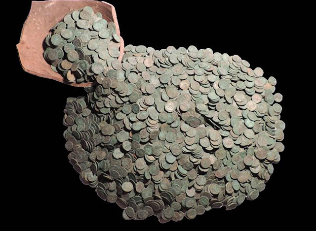 Metal detectorists find largest Roman coin hoard in Britain