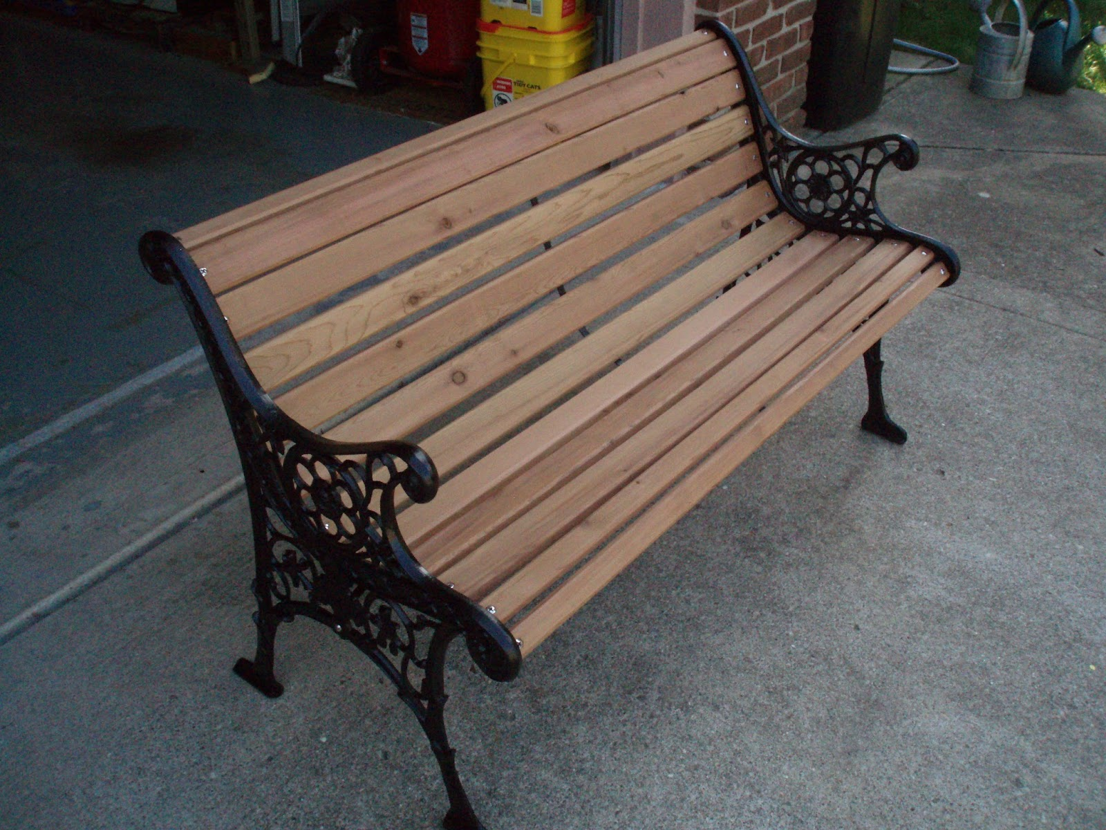 Here Is The Finished Park Bench With Red Cedar Wood And Freshly Painted Wrought Iron